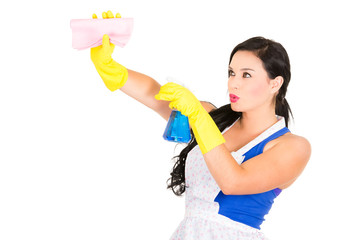 Beautiful young girl wearing apron and gloves cleaning