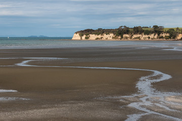 beach at Karepiro Bay at low tide, New Zealand