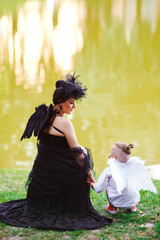 Moter with son playing angel and demon