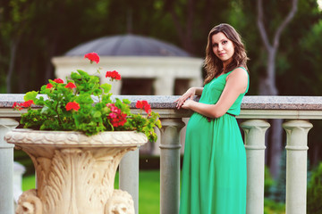 Beautiful pregnant woman feeling lovely