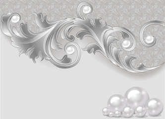 background with a scattering of pearls and a silver ornament