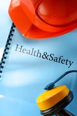 Safety earphones and red helmet