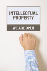 Businessman knocking on Intellectual Property Office door