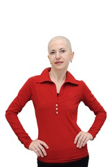 Bald woman in red shirt standing with arms akimbo