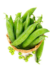 fresh pea in basket isolated on white