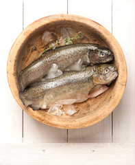 Raw fish for trout in wooden bowl