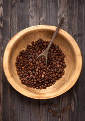 Roasted beans coffee in old vintage wooden bowl