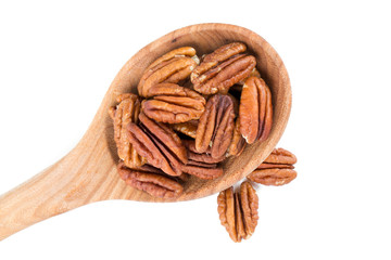 pecan nuts in a wooden spoon