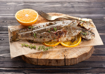 Baked trout fish with thyme and orange