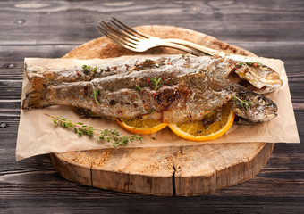 Baked trout fish with thyme