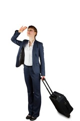 Businesswoman holding suitcase and looking