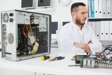 Computer engineer sitting with broken console