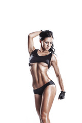 sexy young fitness girl posing isolated over white