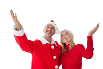 Festive couple standing with arms raised