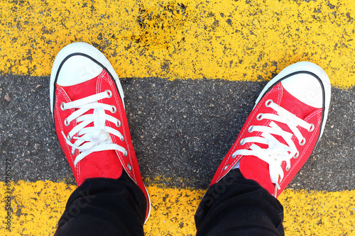 Shoes red on a black ground. - 69365292