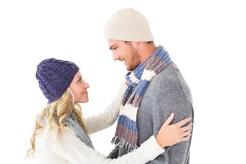 Attractive couple in winter fashion hugging