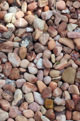 A background of multicolored stones.