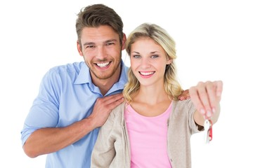 Attractive young couple showing new house key
