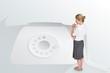 Thinking businesswoman against retro telephone