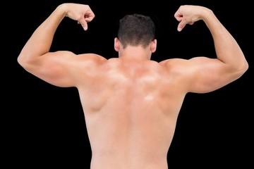 Rear view of a shirtless muscular man flexing muscles