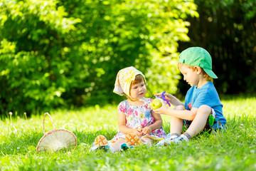 Little boy and girl playing on grass