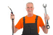 Happy man in orange and gray overall with wrench