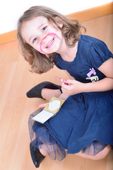 Little cute girl posing while panting her face