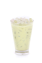 Iced green tea latte in a glass isolated on white background