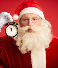 Santa with alarm clock