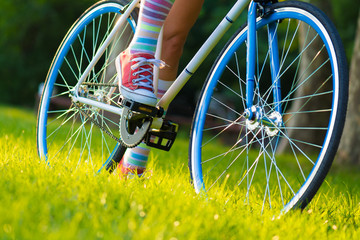 hipster bicycle, woman in colorfus socks