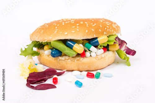Papiers peints Pain Eating medicines with a sandwich