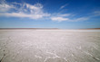 Dry lake under blue sky - 69370044