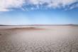 Dry lake under blue sky - 69370054