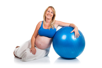 Pregnant woman with blue ball