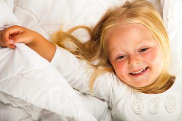 Cute and happy preschool blonde girl