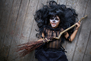 Girl with broom