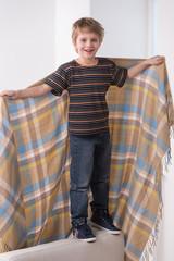 Full length portrait of boy with blanket.