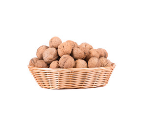 Wicker basket full of walnuts.