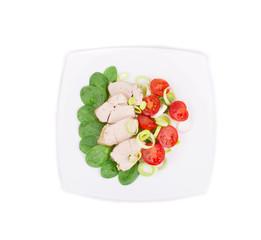 Chicken salad with sliced leek.