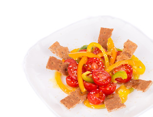 Fitness salad with tomatoes and crackers.