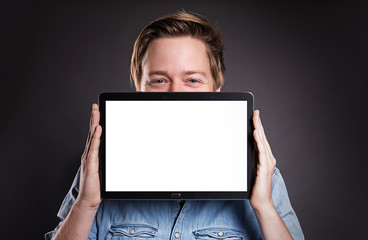 Guy holding a Tablet PC