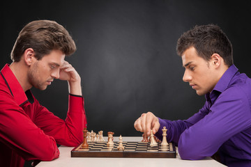 two man sitting and playing chess.