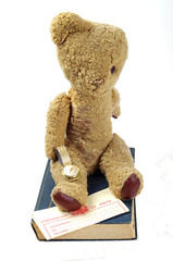 antique book watch and teddy bear