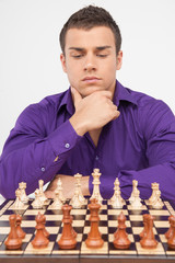 Man playing chess on white background.