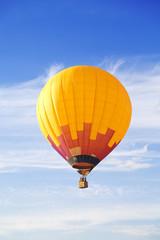 Flying balloon in blue sky