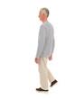 Senior man walking isolated over white background