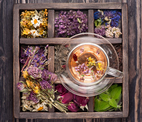 Dried Herbs and flowers  in vintage box and and herbal tea .