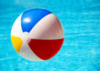 Beach ball in swimming pool - 69373239