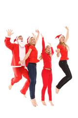 Guppe von Menschen in Weihnachtskostüm springt in die Luft