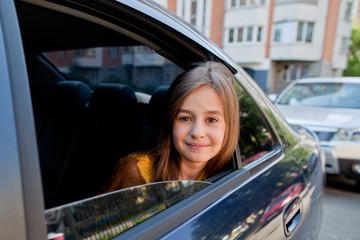 beautiful little girl in the car